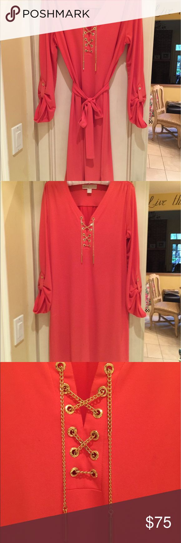 Michael Kors dress Beautiful worn once Micheal Kors orange dress size medium, no signs of wear, polyester with spandex can be worn belted or not. Perfect with leggings or just as a dress. Michael Kors Dresses Mini