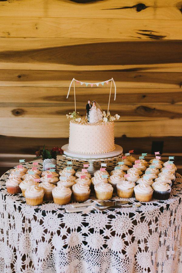 cake and cupcakes! photo by Brett & Jessica http://ruffledblog.com/lady-luck-farms-asheville-wedding #weddingcake #cupcakes