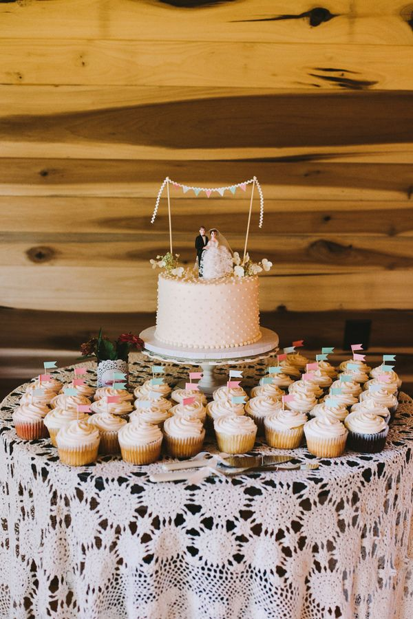 cake and cupcakes! photo by Brett & Jessica http://ruffledblog.com/lady-luck-farms-asheville-wedding #weddingcake #cupcakes