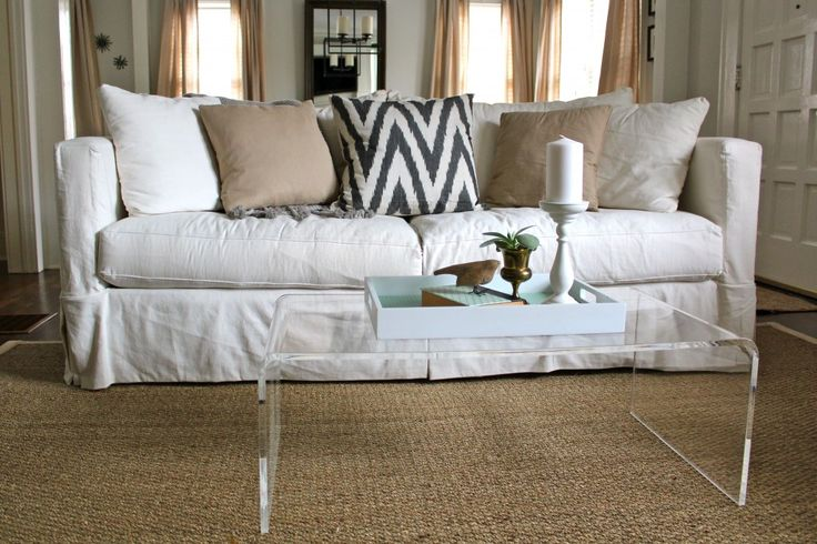 white sofa cover with wooden table | White slipcovered sofa, natural fiber rug, lucite coffee ...