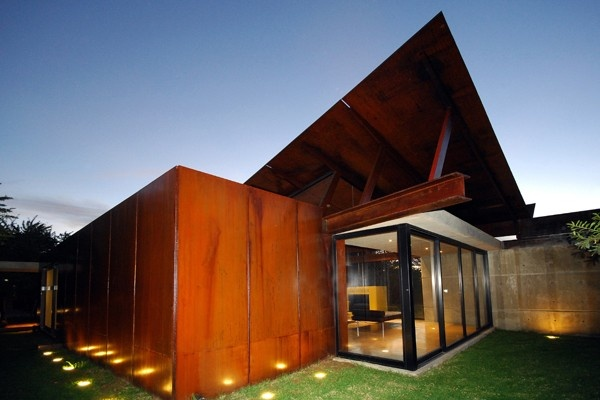 Fantastic use of nature light in this design. Incredible roof lines.