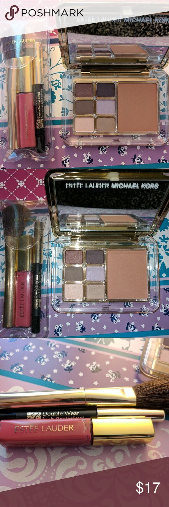 Estee Lauder Michael Kors Makeup Set A mirrored palette of eyeshadow and bronzer PLUS a black liner pencil, a rich colored lip gloss, and a makeup brush, all by the Estée Lauder and Michael Kors collaboration. Six beautiful eyeshadow colors with a large bronzer pan. Never used - received as a gift. First picture of the set is with no flash, second picture of the set is with flash. Swatches or more pictures available upon request. Estee Lauder Makeup