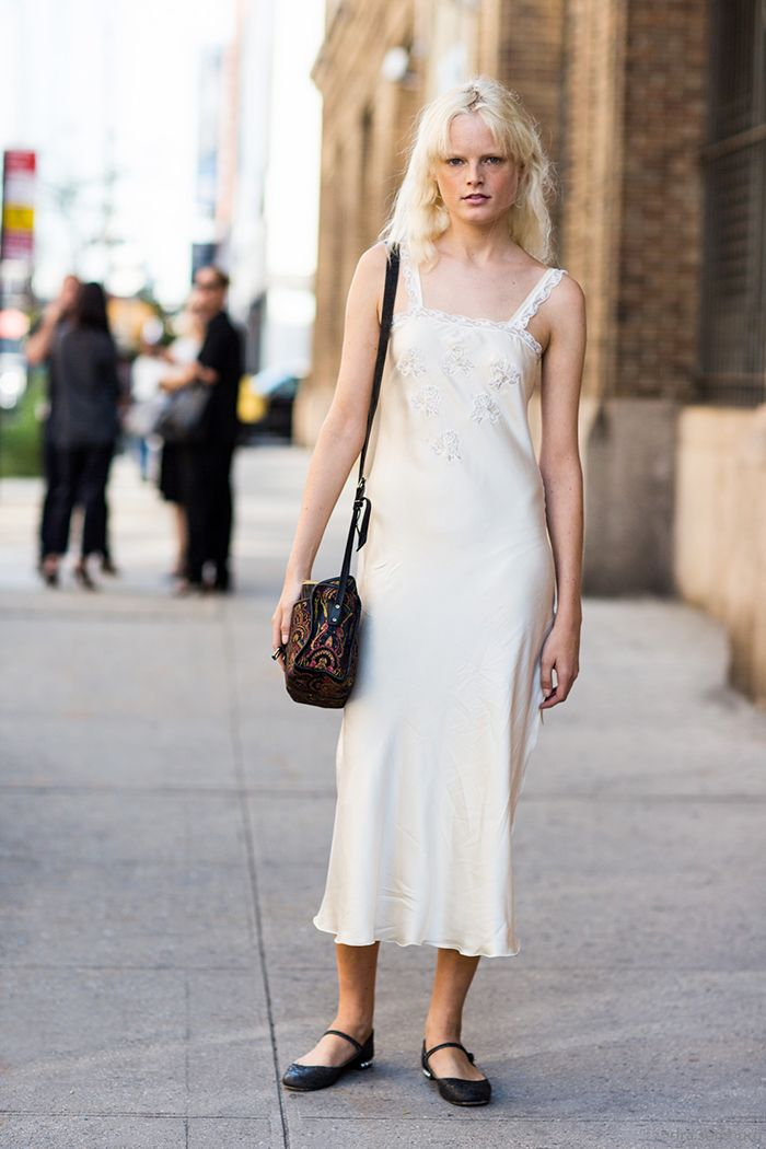 Hanne Gaby Odiele wears a lace slip dress, Mary-Jane flats, and a shoulder bag