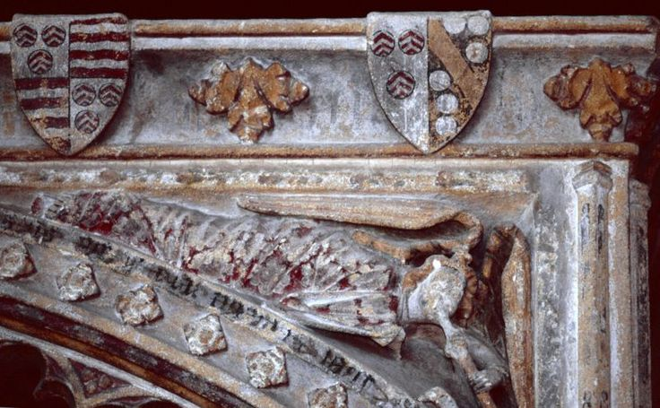 A photo of the alter tomb at the Church of St. Nicholas, Henstridge, Somerset, England of William Carent and Margaret Stourton (1463).  Shields are Carent (argent, three torteaux each charged with three chevronels gules) quartering Toomer (gules, three bars wavy argent) and Carent impaling Stourton (sable, a bend between six fountains).