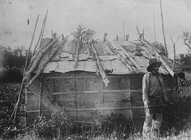 Ojibway hut on Bear Island, Leech Lake. Photograph Collection, 1905. Minnesota Historical Society
