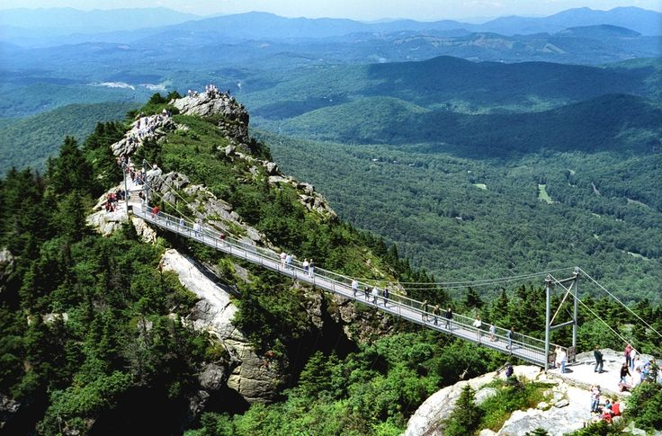 Grandfather Mountain North Carolina --- talk about being able to see for an eternity ..that's what being on that swinging bridge is like ...breath-taking!! This is where Billy Joe Patton has his golf tee.  Went across this - scary!