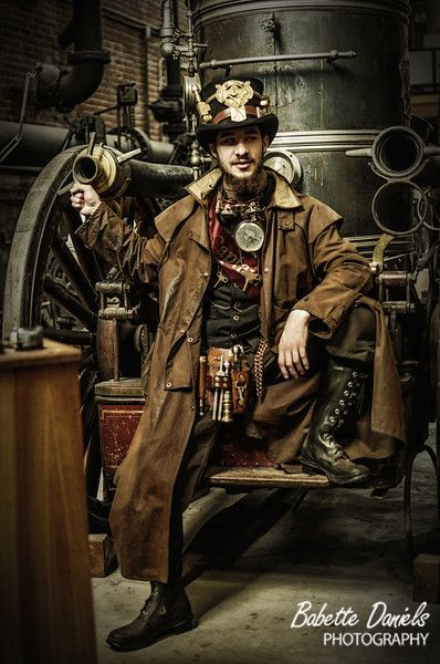 Steampunk Gentleman. Gorgeous coat, good boots, nice embellishments, more men should wear this style! Victorian villain? He looks more like a cheeky anti-hero.  Photo and editing © 2010 - 2014 Babette Daniels. - The photography is great too!