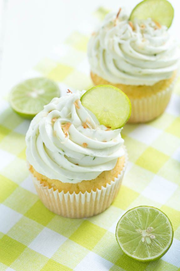 Coconut Cupcakes with Key Lime Buttercream Frosting are a delectable treat with fresh key lime flavor! A coconut cake is filled with coconut filling and topped with fresh key lime buttercream!