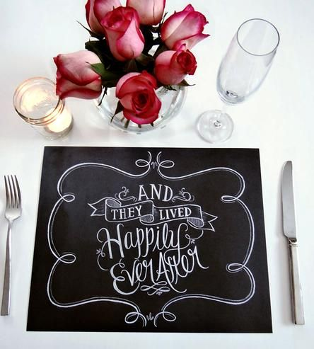 """This set of unique tear-out placemats are a perfect detail for your vintage or rustic-inspired wedding. """"And they lived happily ever after"""" is hand-lettered in chalk, then digitally converted and printed on a weighty matte/satin cardstock. It has a mighty fine realistic chalkboard look."""