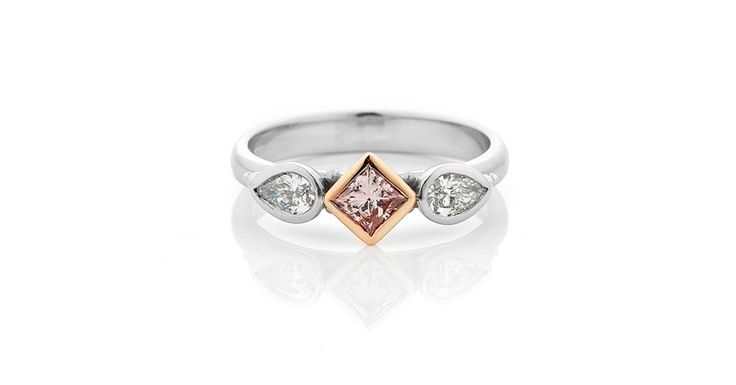Rare Argyle Pink Princess Cut Diamond in rose gold bezel setting with pear shape white diamonds in white gold