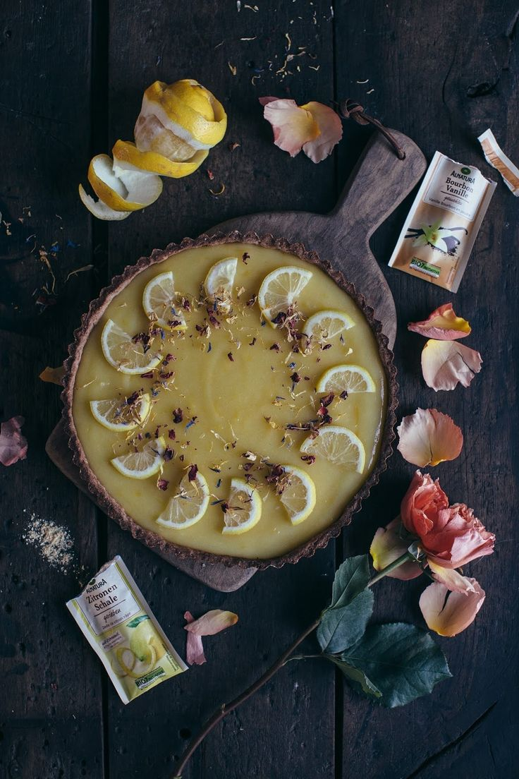 Gluten-free lemon tart with homemade lemon curd and edible flowers inspired by an old oil-painting