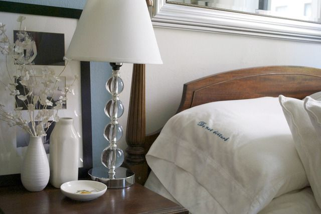 "Gorgeous bedside. PAINT & COLORS    •Walls: Benjamin Moore ""White Dove""  •Trim: Benjamin Moore ""White""  •Feature wall: Benjamin Moore ""Old Pickup Blue"""