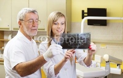 Dentist and assistant