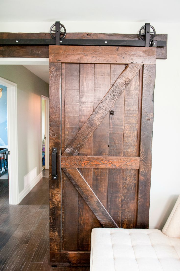 Fantastic barn door, authentic look, great hardware, beautiful patina and stain. A super example of an interior barn door!