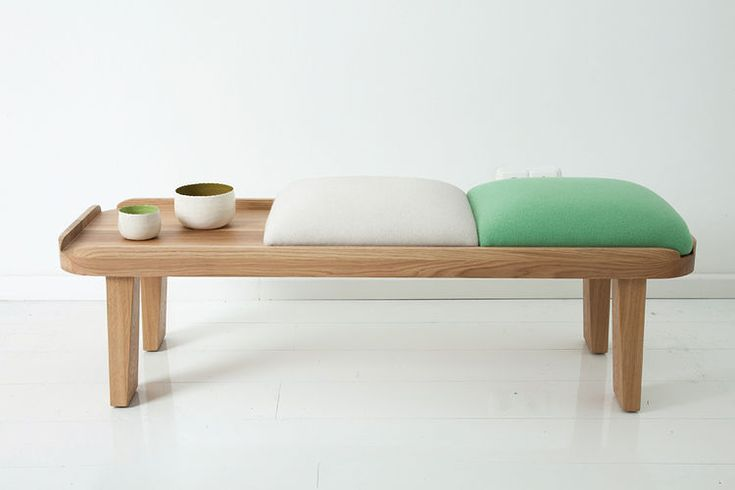 Japanese-inspired tea bench with white and green cushions