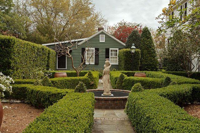 A beautiful sculpture helps define a small fountain or pond. Image via Flickr user Ken Dodds   - Veranda.com