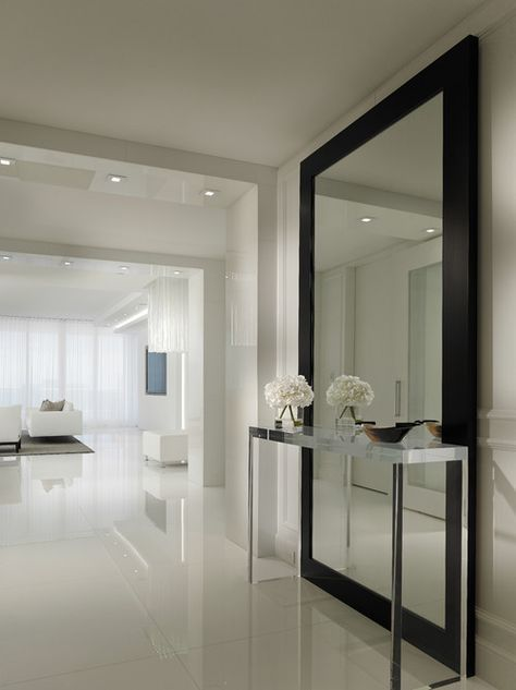 Contemporary Hallway Design Ideas With Stainless Console Table Also Huge Modern Mirror With Black Frame Also White Tile Floor Also White Wall Paint Color Also Small Ceiling Lights Also White Modern Furniture: Hallway designs to Make Your House Better