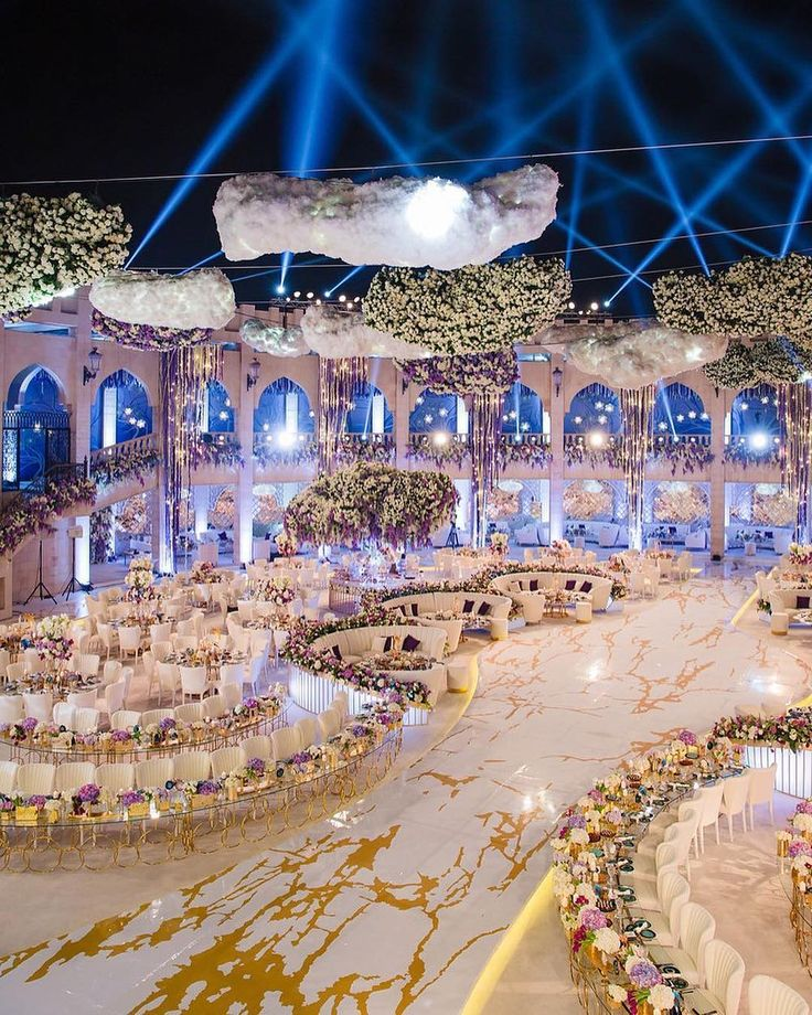 Between the unique table shapes and suspended floral installations, this #Dubai wedding by @ibentoevents is truly statement-making.  via @filmatography