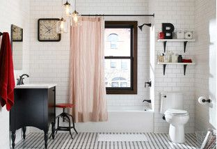 Give your bathroom an industrial edge with finds fit for a downtown loft. Pair matte porcelain tiles with shiny steel fixtures for a cool contrast, and add a clawfoot tub for a vintage vibe. Wrap it up with bath linens in a single accent color to offset the neutral black and white palette.