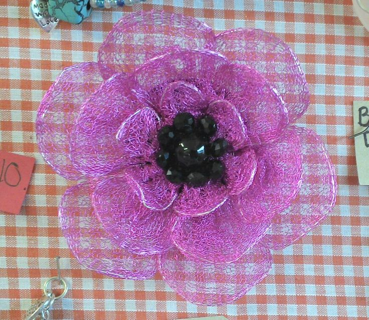 Wire mesh flower brooch with blacl oynx and chezck crystal