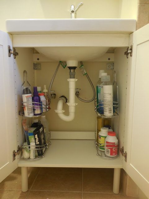 You should also put shower caddies under the sink for storage that will actually stay de-cluttered. | 15 Genius Dollar Store Bathroom Hacks Because Mess = Stress