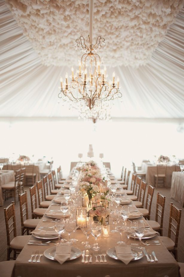 dreamy white wedding dinner tent and chandelier. look at that ceiling fabric!