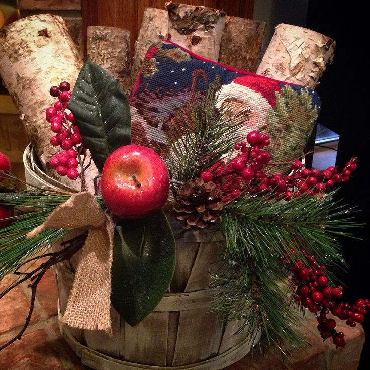 Repurposed bushel basket! Added a super sheer coat of antique white paint and 2 Christmas picks. Plopped in some birch logs and a mini Santa pillow. Love it!❤️❤️