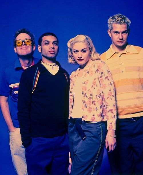 Gwen Stefani Through the Years - 1997 The No Doubt quartet pose for a group shot, with Tom Dumont, showing his slightly silly side in the back. Gwen admitted to Harper's Bazaar that she lived with her parents until she was 25—and even had a midnight curfew for the prom she attend with band mate Tony Kanal (center left).