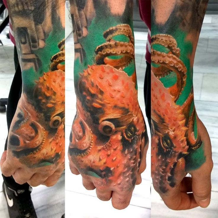 realistic color octapus tattoo by SKERYONE
