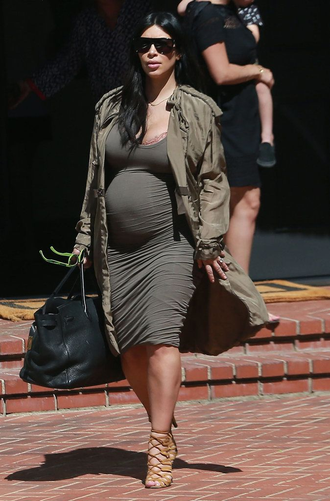 Kim Kardashian flaunts her growing baby bump on a selfie-worthy lunch date. Click through to see more snaps of her maternity style.