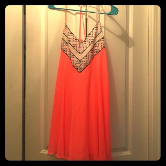 Neon coral colored sundress Cute cute bright coral sundress that I bought for my vacation and wore only a couple times. Super pretty and flowy City Triangles Dresses