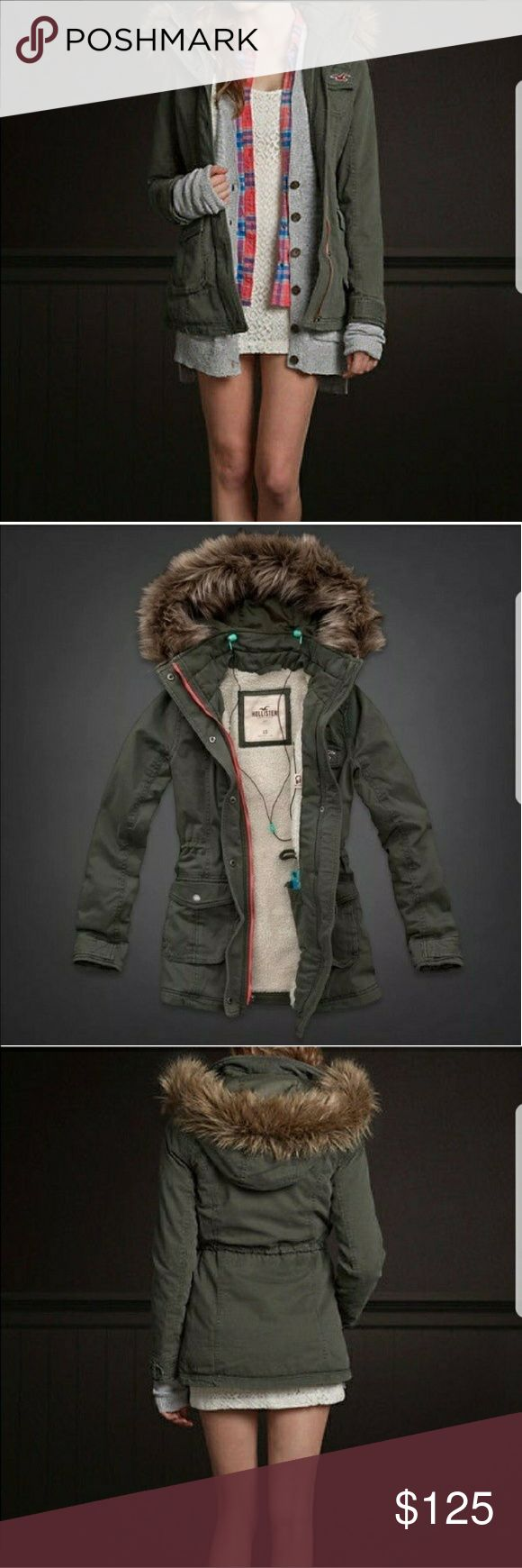 """New Hollister Faux Fur Sherpa Lined Jacket Bundle up during the colder weather with this faux fur jacket from Hollister by Abercrombie and Fitch. This coat has a faux fur hoodie and Sherpa lining inside which will keep you not only warm but stylish as well. Features: pockets, snap closure buttons, seagull embroidery, convenient tag to hold your earphones, inside pocket, and detachable faux fur. Material: 100% cotton. Rough Measurements: bust 34"""" waist 28"""", sleeve length 25.5"""", jacket length…"""