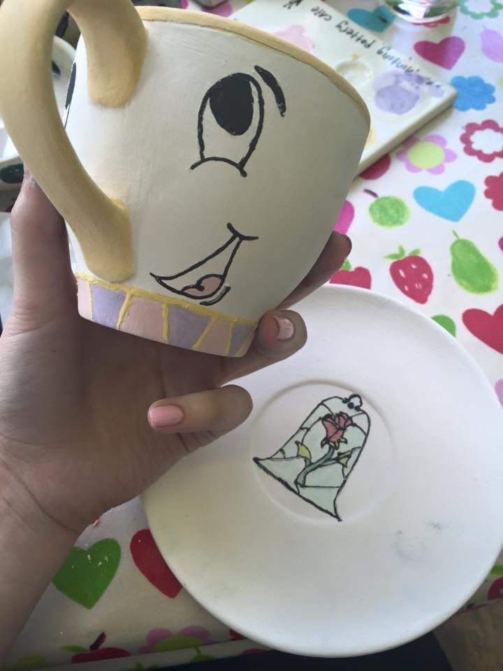 Before being fired and glazed. My Beauty and the Beast themed pottery painting.   Take as old as time..   Chip the cup and glass mosaic rose on a saucer.