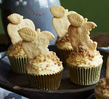 These extra-special cupcakes taste just like traditional crumble and custard - top with cream icing and apple-shaped biscuits
