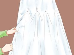 How to Bustle a Wedding Dress --  We may need to bussle the dresses for the tournament via wikiHow.com