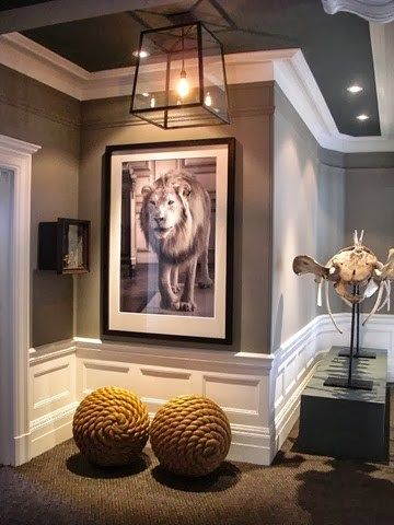 martha stewart zinc is used in this hallway to accent the crown and decorative moulding which makes the ceiling look higher