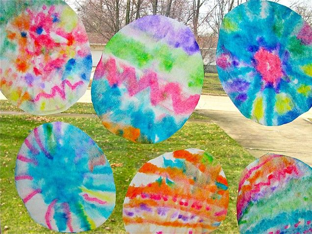 Easter Crafts For Kids - coffee filter cut into egg shape, draw on with marker, spray with water and let colors bleed.
