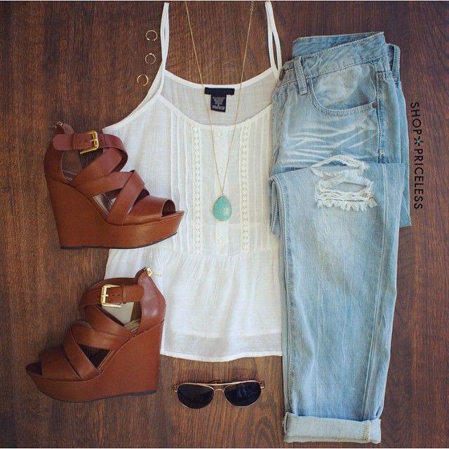 White shirt blouse, light blue jeans, beige sandals, necklace. Summer outfit