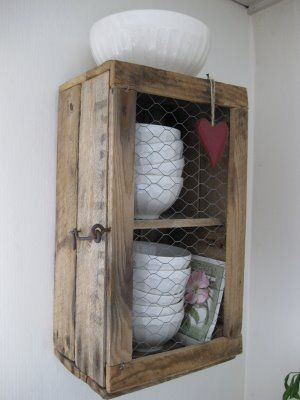 Crate made into cabinet- plus chicken wire. Maybe a good project to repurpose a pallet. With Pic Instruc.