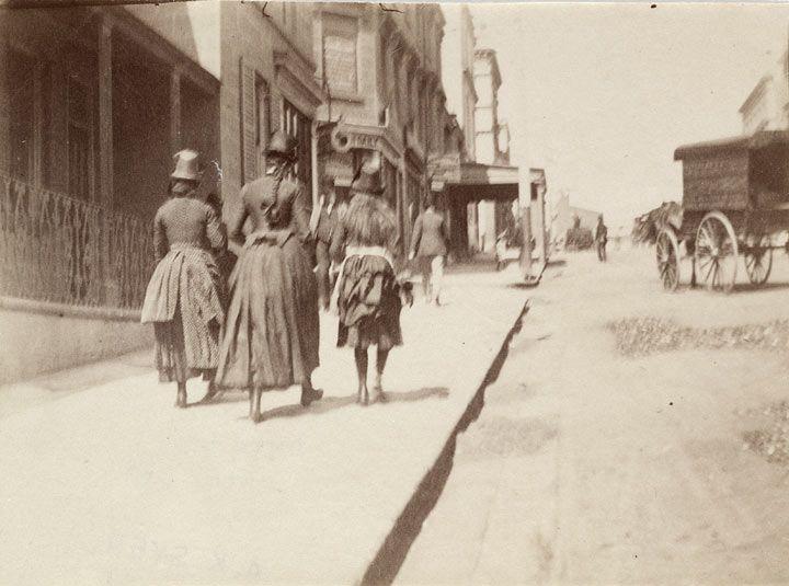 Three girls walking up William Street near McElhone Street, Kings Cross