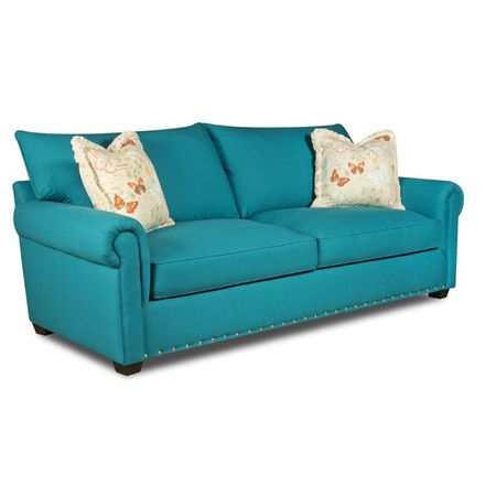 Sofa with peacock-hued upholstery.   Product: SofaConstruction Material: Oak, plywood and polyesterColor: ...