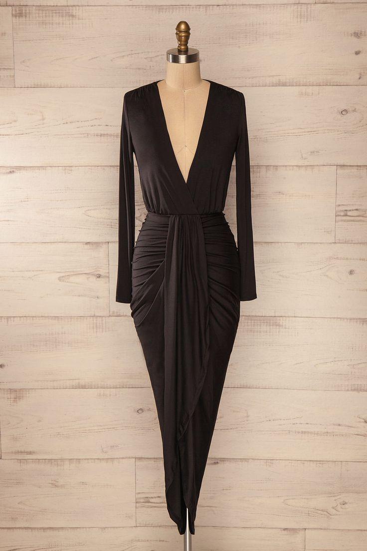 Cette robe avec ses drapés angulaires complémentera parfaitement les courbes féminines.     Black fitted asymmetric wrap dress www.1861.ca