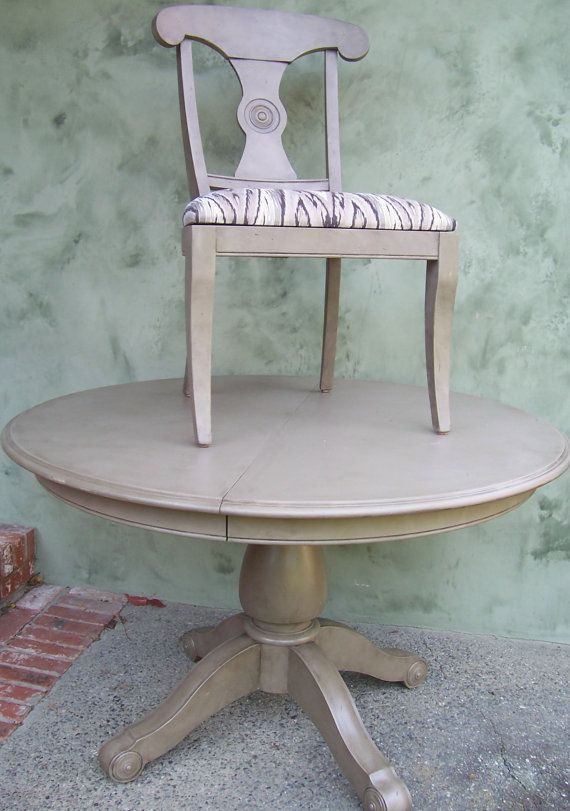 "4' round pedestal table, 1 leaf(18"") and 6 matching dining chairs. Hand painted in Annie Sloane Chalk paint( color is COCO) by hand, then glazed w/antique finish."