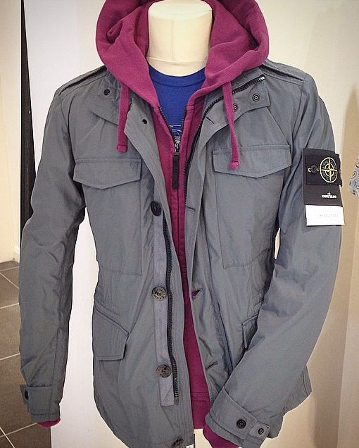 MIxing it up with Colour in a look which is top to toe Stone Island. Stone Island Micro Reps Grey Jacket, Stone Island Purple Full Zip Hooded Sweatshirt and Stone Island Large Logo T-Shirt in Royal Blue. All available online @ www.Robert-Fuller.co.uk