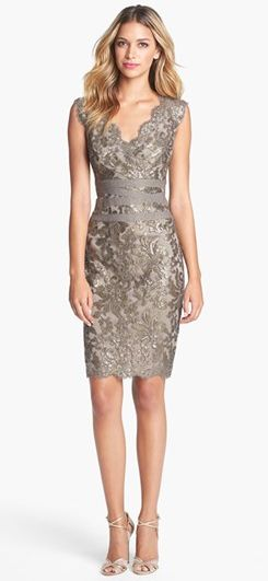 We have always been partial to the vintage bodice, and this one is no exception. How lovely a neckline can you make?! Embellished metallic sheath dress