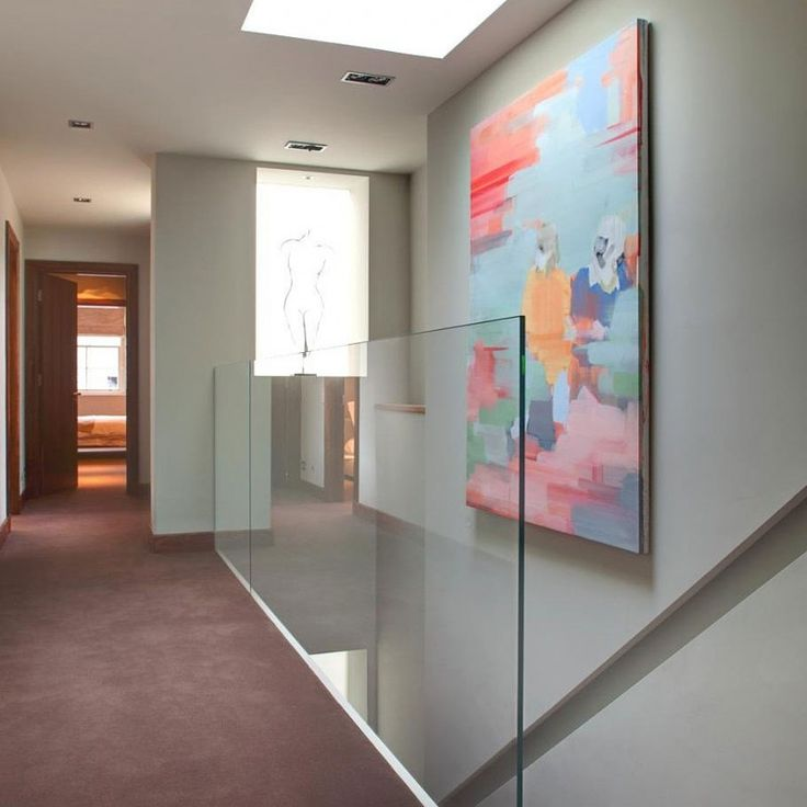 : Colorful Abstract Painting Studded On Center Wall Of Kensington Penthouse Stairwell With Glass Balustrade