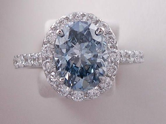 Amazing 3.00 ctw Oval Cut Diamond Engagement Ring with a 2.15 Carat Fancy Intense Blue Oval Cut Lab