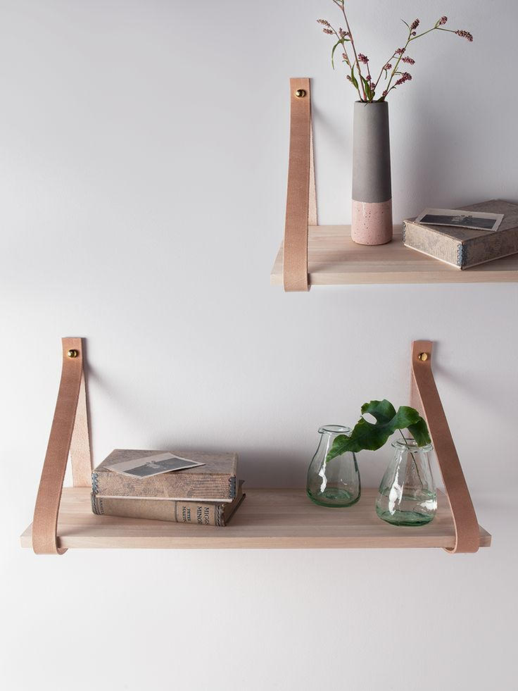Beautifully crafted from sturdy raw oak with two soft and strong leather  straps in two sizes, our wood and leather shelves are a modern twist on a  classic ...