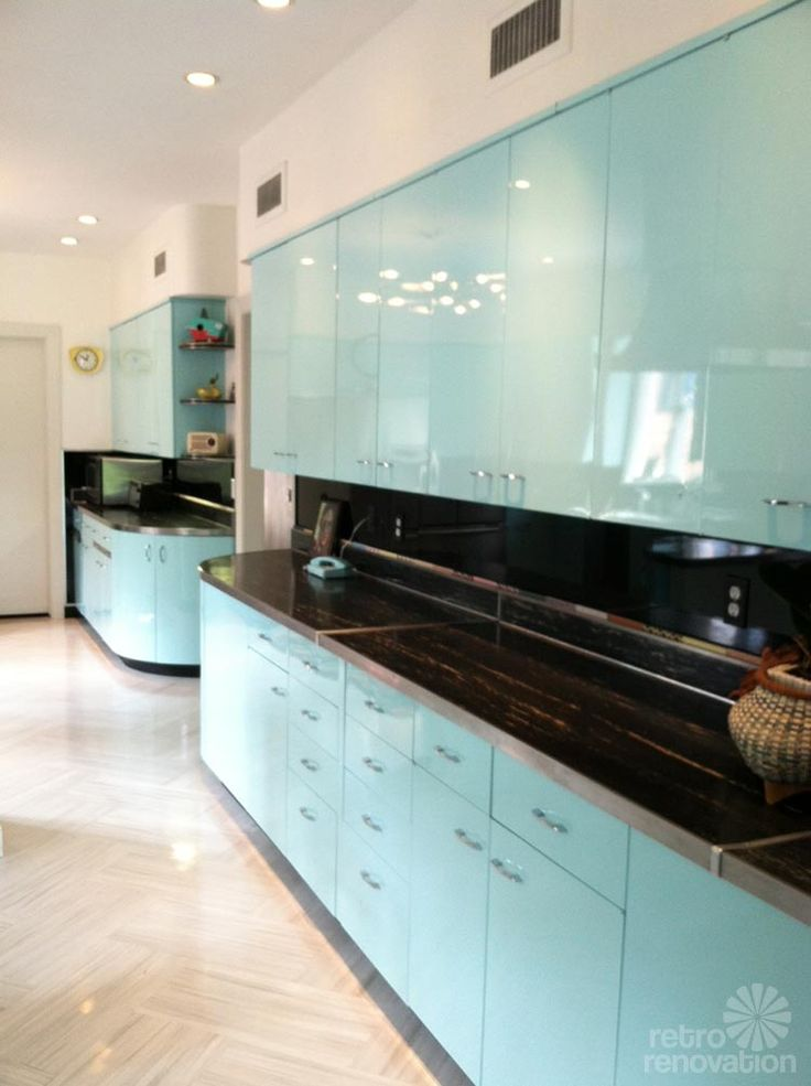 "Beautifully refurbished vintage metal kitchen cabinets, repainted with PPG auto paint. The flooring is Armstrong's Striations line in the ""atmosphere"" color. 