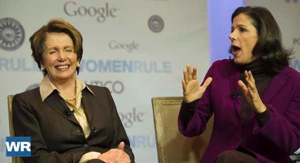 Democratic Leader Rep. Nancy Pelosi (D-Calif., left) and her daughter and filmmaker Alexandra Pelosi (right) speak at the Women Rule Marks of Leadership summit.  | POLITICO